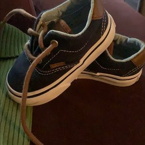 Navy and brown Vans